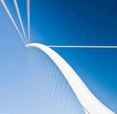 ~ the newest bridge over the river Liffey ~ (Janey Kay) Tags: bridge blue ireland sky dublin june juni clouds square puente juin himmel cu irland eire ponte bleu ciel cielo squareformat pont blau harp nuages nuvem brcke nube santiagocalatrava irlande 2010 carr passerelle harpe whiteonblue wolden colouredsquares formatcarr sigma2470mm28 janeykay nikkor2470mm28 samuelbeckettbridge sigma2470mmf28exdghsm nikond300s bridgeovertheriverliffey squaresincolour carrscoulors carrencouleurs ithinkitlookslikeaharp