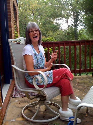 Mom playing Words With Friends on her iPod Touch on the front porch