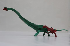 Origami Acrocanthosaurus and Sauroposeidon - front view 1 (Tankoda) Tags: roar challenge design june forum origami threopod sauropod cellulose methyl mc white red green paper tissue double attack battle dinosaur art nolan travis sauroposeidon acrocanthosaurus