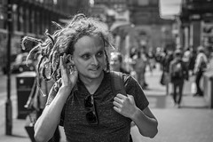 Dreadlocked (Leanne Boulton) Tags: urban street candid portrait portraiture closeup streetphotography candidstreetphotography candidportrait streetportrait streetlife medusa man male face facial expression look emotion feeling mood hand gesture dreadlocks hair backlit backlighting tone texture detail depthoffield bokeh naturallight outdoor light shade shadow city scene human life living humanity society culture people canon canon5d 5dmarkiii 70mm character ef2470mmf28liiusm black white blackwhite bw mono blackandwhite monochrome glasgow scotland uk