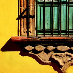 window macro (msdonnalee) Tags: window yellow mxico jaune mexico ventana shadows fenster  finestra gelb giallo shutters mexique janela amarilla yellowwall mexiko messico finestre venster   i   artlegacy colorartawards artofimages bestcapturesaoi wroughtirongrill photosbydonnacleveland pareddeamarilla bluegreenshutters carvedstonewindowframe