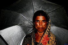 Get the Message (bandashing) Tags: poverty england woman brown umbrella asian manchester poor beggar cheeks pout sari sylhet bangladesh defenition bandashing january2010entrysoulwoman