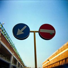 Politicamente scorretto (Kazze) Tags: street camera italy signs milan 6x6 film toy holga lomography strada italia milano left cartello medio divieto formato sinistra analogico svolta lampugnano
