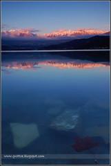 Lo Specchio - The Mirror (Enrico Grotto) Tags: santa sunset mountain color reflection foglie landscape lago mirror italia tramonto nuvole cielo lee neve acqua colori alpi montagna luce paesaggio belluno dolomiti 1224 croce specchio riflesso gnd d40 cluod nikkor1224 alpago nikond40 grottoenrico