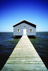 Crawley Edge Boatshed LOMOed (KC Tan Photography) Tags: blue water 35mm river lomo lca xpro lomography crossprocessed jetty slide plastic perth crossprocessing agfa kingspark midday westernaustralia swanriver boatshed crawley ctprecisa100 minitar  daviddicks jonsanders kingsparkavenue crawleyedgeboatshed  leningradopticalmechanicalamalgamation