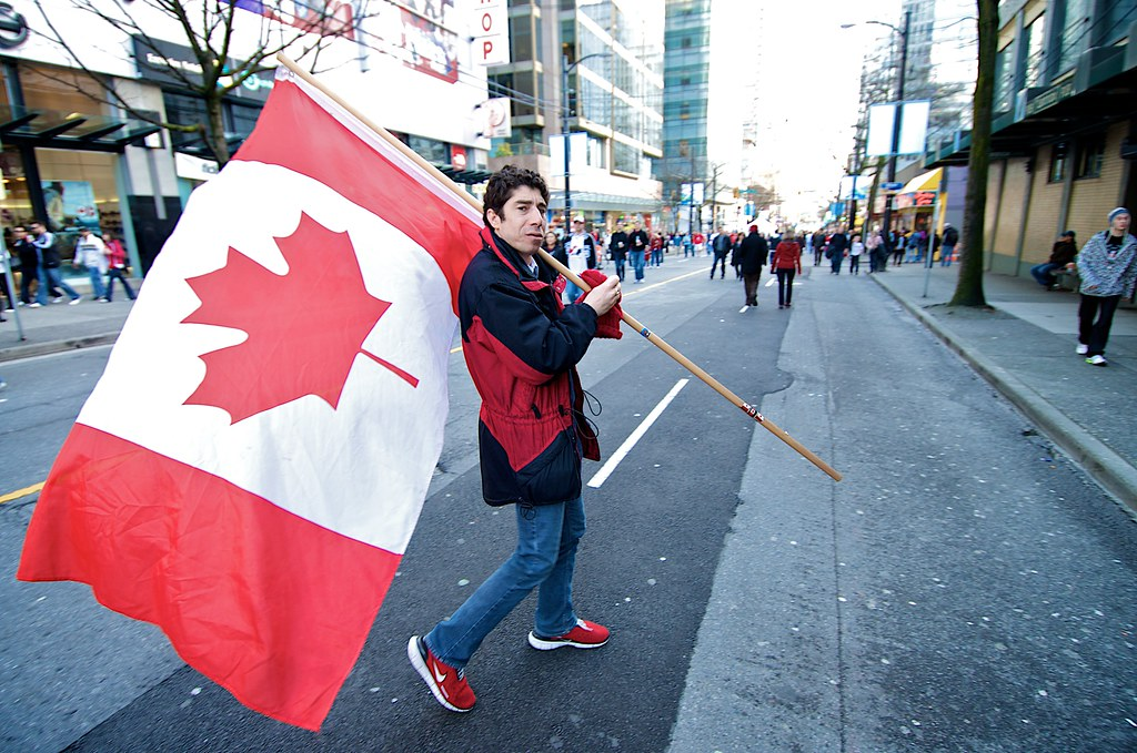 Man Carrying Canadian Flag