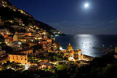 Positano by Night (Pierpaolo.) Tags: life trees sea summer sky italy panorama moon holiday mountains tourism beach church nature water beautiful alberi night contrast montagne stars landscape boats lights evening italian holidays europa europe paradise mediterranean mediterraneo italia mare campania estate view natural magic august natura panoramic luna hills agosto porto cielo vista napoli moonlight luci acqua turismo 2009 spiaggia notte breathtaking vacanze cartolina colline golfo sera magico stelle bellissimo costieraamalfitana tirreno canoneos30d manfrotto190xprobtripod manfrotto486rc2head sigma10201020mmexdc