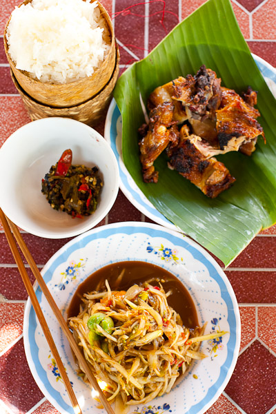 Sticky rice, grilled chicken, papaya salad and a dip of grilled chilies, Vientiane, Laos