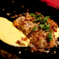 Prawns with Crispy Parma Ham Topping Served with Creamy Garlic & Saffron Sauce