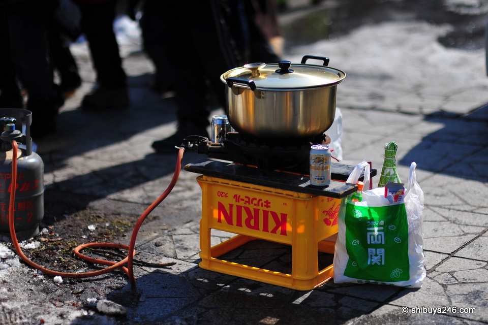 A portable gas bottle and a makeshift Nabe. Looks like the chefs might have had a few drinks too.