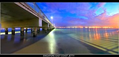 Singapore Marine Parade jetty (Kenny Teo (zoompict)) Tags: longexposure bridge blue light sunset sea sky cloud seascape reflection tourism beach water beautiful night canon wonderful seaside scenery photographer waterfront view nightout walk jetty sigma wave tourist best east kenny seaview bedok photoimpact bedokjetty canoneos500d zoompict kennyteo sigmawideangle1020mmlens teosengchye eastcoastjetty singaporelowerpiercereservoir