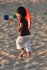 The Red Peril (Ctuna8162) Tags: red smile umbrella fun happy hawaii kid sand waikiki honolulu