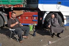 TRUCKING IN LEBANON (Claude  BARUTEL) Tags: road lebanon water truck transport pipe smoking eat driver middle beirut trucking chicha
