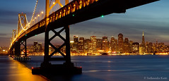 Bay Bridge and the Skyline, San Francisco, CA (Sudheendra Kadri) Tags: ocean sanfrancisco california city sunset northerncalifornia skyline gold lights bay glow cityscape treasureisland pacific baybridge starburst sudhi yerbabuenaisland sudheendrakadri