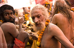 An emaciated and old Naga Baba at the Kumb Mela, Haridwar (sanjayausta) Tags: pictures old people india men saint festival naked nude religious bath asia nudes indian faith religion festivals traditions smoking full holy pot gathering take warrior ritual aged procession bathing nudity marijuana population devotees hindu hinduism dip festivities maha crowds baba sanjay babas largest sadhu 2010 naga rituals mela nagas haridwar the photoessay throngs austa sadhus kumbh photodocumentary ascetics