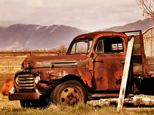 ford rusty truck near clinton overlay sepia darker sky