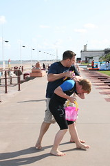 E.R.O.Y (Pint of Cream) Tags: uk england people beach see is bucket fight couple who dom wrestling cost strangers sunny best wilson shorts fighting grab bully wetsuit grabbing photogaphy domwilson wwwdomwilsoncom domwilsoncom