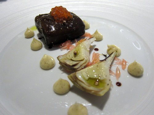 Salmon poached in licorice gel served with an artichokes vanilla mayonnaise.