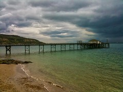 Totland Bay Pier (There and back again) Tags: sea holiday storm clouds photoshop landscape pier isleofwight 3gs iphone totlandbay