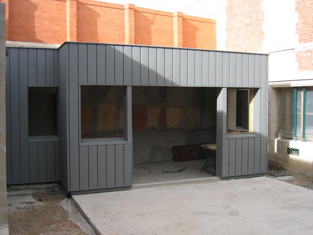 Photo de construction de maison moderne toiture zinc