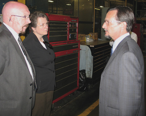 Aztec Manufacturing President and CEO Greg Lopez (right) speaks with Agriculture Deputy Secretary Kathleen Merrigan and