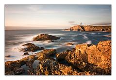 Gold Sunset II (Javier Paris) Tags: longexposure sunset sea lighthouse rock golden coast rocks hour