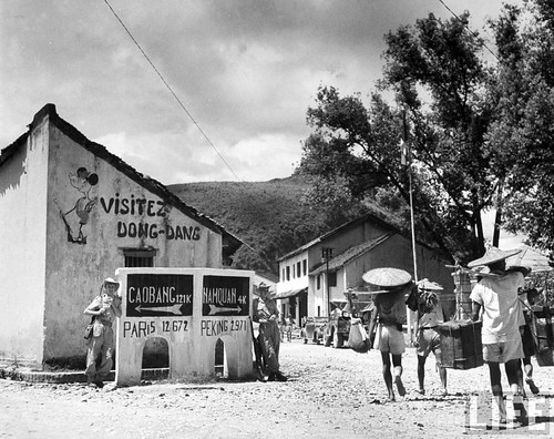 July 1948 - Center of frontier town, displaying a drawing of Mickey Mouse on building, in French Indo China.