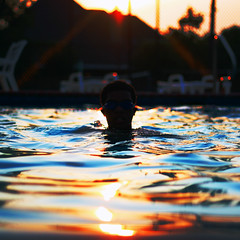 Color Splash (Austin Sullivan) Tags: blue sunset color reflection water pool swimming canon austin photography 50mm rainbow dof bokeh goggles sullivan kameron
