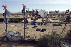 Roadside14 (Alix!) Tags: california abandoned fence highway shoes desert random roadside shoetree highway62 hwy62 ca62 riceshoefence