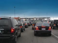 traffic backs up on the SF-Oakland Bay Bridge (by: Gohsuke Takama, creative commons license)