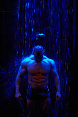 Cooling down (LalliSig) Tags: blue red portrait people man motion black water muscles training dark waterfall iceland moody sam class portraiture shoulders bodybuilder sixpack maggi wold trainter