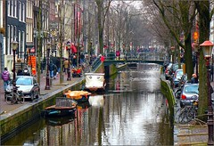 Amsterdam in one shot (jackfre2 (on a trip-voyage-reis-reise)) Tags: trees houses red people cars netherlands amsterdam sign reflections boats canal panel crowd bridges bicycles striptease hahahaha cafs oudezijdsvoorburgwal lampposts peepshows yourtags mygearandmepremium mygearandmebronze mygearandmesilver pornoshows alittlebitfog