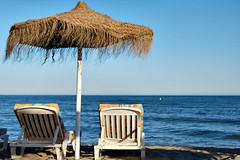A View For Two (HaHa UK) Tags: blue sea brown sun beach yellow swimming swim spain sand europe chairs shade costadelsol malaga sunbathing fuengirola torreblanca