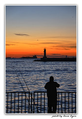 Alone (Emre Ergin) Tags: sunset sun lighthouse turkey fisherman nikon alone loneliness trkiye istanbul trkei fisher beacon tek nikondigital kadikoy haydarpasa gnbatm yalnz d90 denizfeneri balk nikondslr yalnzlk nikond90 thebestofday gnneniyisi istanbullovers nikond90tr