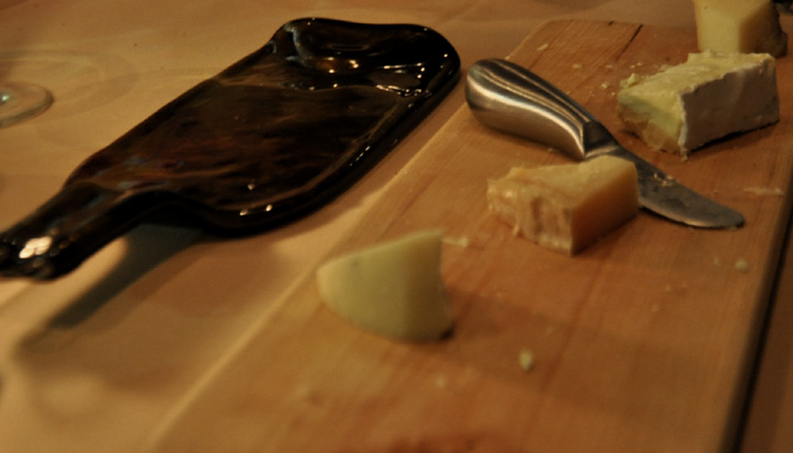 cheese, and a plate made out of a bottle