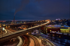 Morning rush hour: Stockholm (AbhijeetVardhan) Tags: longexposure morning bridge winter light urban snow cold cars window dawn hotel nikon traffic sweden stockholm trails globen clarion eriksdalsbadet d90 inspiredbyyourbeauty