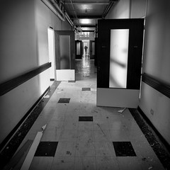 Come with us (Julien Ratel ( Jll Jnsson )) Tags: bw white black france building abandoned canon hospital square noir doors corridor nb tokina sanatorium hopital blanc wrecked couloir batiment carr cmc urbex portes abandonn thechemicalbrothers isre looted 1224f4 40d pill dmoli comewithus blueju38 julienratelphotography lespetitesroches juliendesclics missclic centremdicochirurgical ddicacedelasrie