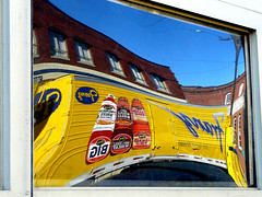 Crazy Bread Truck (Oh Kaye) Tags: blue sky distortion building window yellow oregon portland relections breadtruck