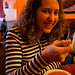 Student Mary Dunn enjoying Coconut soup at Earth and Tea Cafe.