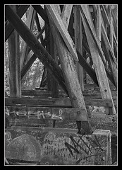Railroad trestle- Carrboro, NC (Nate Montgomery) Tags: blackandwhite graffiti northcarolina carrboro wilsonpark railroadtrestle bolincreek