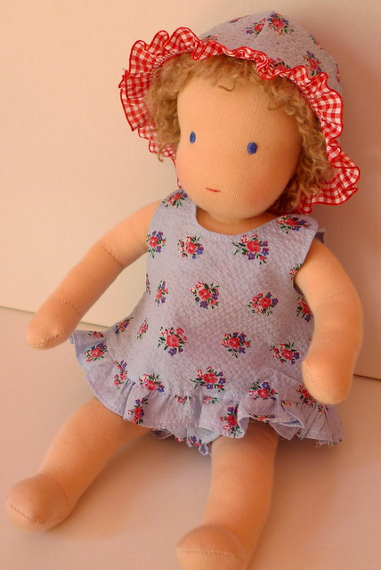 Mia's baby Sally in her sun suit and sun hat