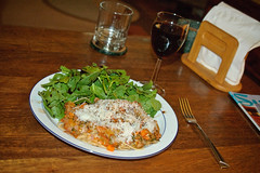 Spaghetti with locally grown tomatoes in a meat sauce, served with locally grown lettuce and arugula.