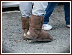 Classic short UGG boots worn by young girl - O...
