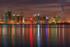 Manama City Lights (©Helminadia Ranford) Tags: city reflection modern canon buildings lights bay bahrain arabic arab arabia bluehour manama 2470mm 50d