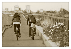 Riding Couple (Michele Cannone) Tags: monochrome sepia cycling couple ride riding badge bycicle foggia cerignola trinitapoli