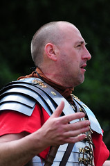 Roman Soldier with Breastplate, Ermine Street Guard, Kelmarsh Festival of History 2009 (Steve Greaves) Tags: red italy rome field leather silver army gold countryside italian ancient war uniform catchycolours dress arms roman juliuscaesar military battle event hedge imperial conflict soldiers warrior historical recreation gesture shavedhead armour period invasion reenactment troops romanempire shaven reenactors authentic legion invading armoury reconstruction invaders cohort legionary livinghistory reenacting gesticulating warfare breastplate englishheritage romansoldier kelmarsh erminestreetguard battledress romanarmy croppedhair kelmarshhall paxromana nikond300 fightingforce 43ad