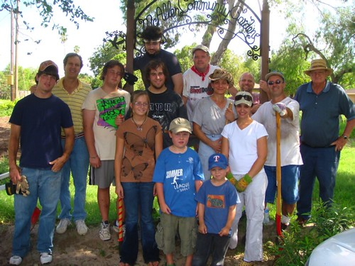 McAllen Community Gardeners. This photo shows some of the gardeners aged 8 to 80+. The gardeners have just finished spreading manure and compost on the garden.