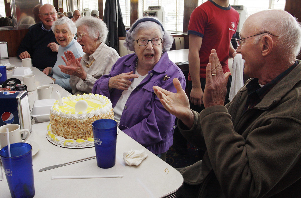 April 13, 2010 - Annette O'Leary's friends clap after she (with a little help) blows out the candles on her cake at the Route 9 Diner. O'Leary's 97th birthday was in January of this year. She is a retired teacher of Northampton and meets with her teacher friends on the 2nd tuesday of every month for breakfast, today it was lunch and a birthday celebration. Sitting next to her are Wally Brown (right) and on her other side is Andrea Uhlig, Ruth Barton and Bill Johnson.