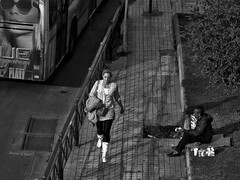opposites (nikman.) Tags: bw woman white man black canon walking sitting poor rick athens greece colored d10 nikman