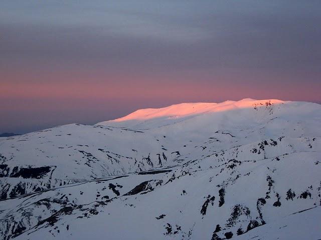 Changing light hits the upper slopes of Tajos de los Machos